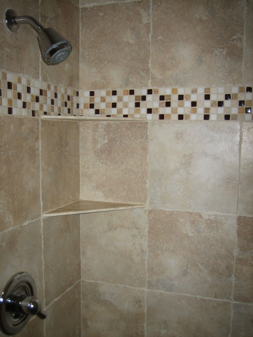 bahtroom: a shower space with light brown tiles for walls