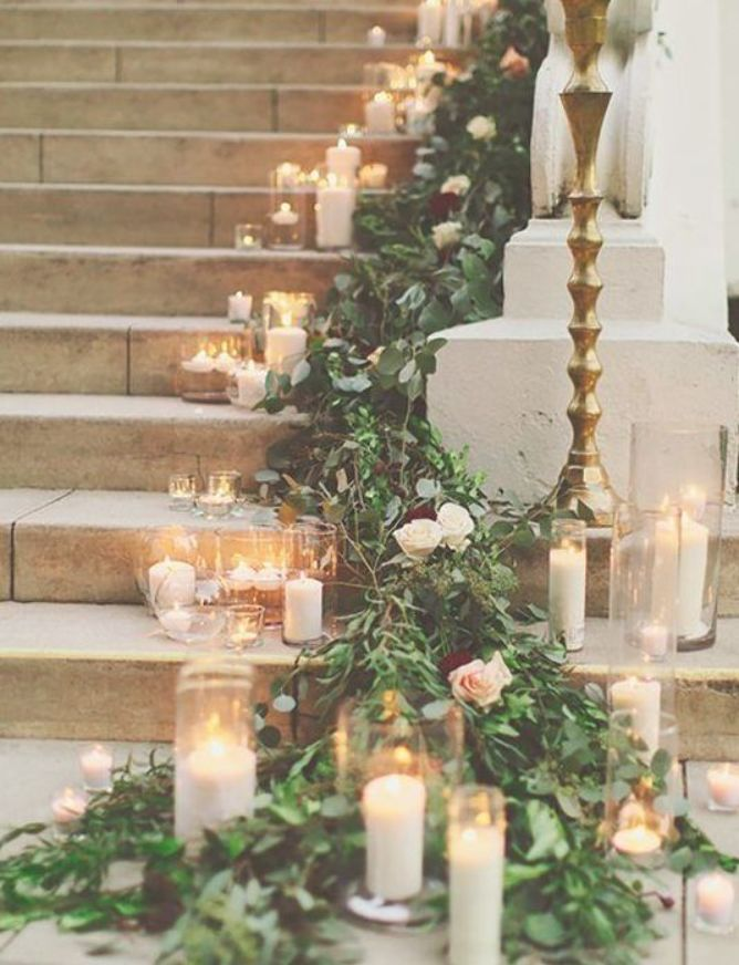 Decorate Pentney Abbey with masses of lush green foliage and white candles at your winter wedding in Norfolk #whitecandleswedding
