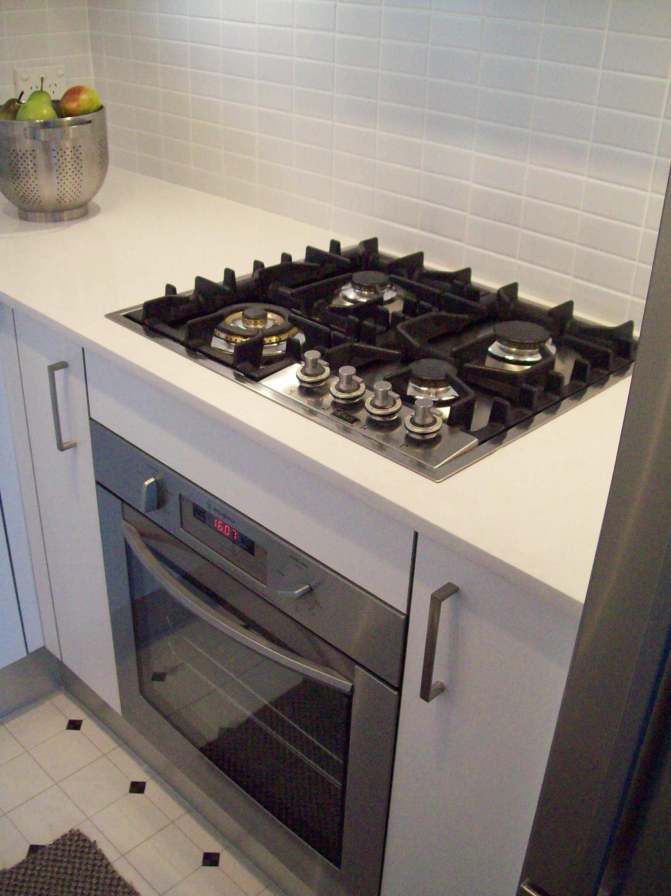 Gas cook top underbench oven and pull out units either side for