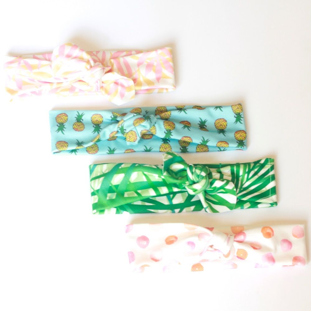 Our summer collection of headbands embrace bright, colorful prints reminiscent of all the things we love about summer. Pineapples, palm branches, and some water color dots - because on rainy days in the summer, painting with watercolors and making a mess was the best activity of choice. Style it with a retro swimsuit or a boho look of cut off shorts