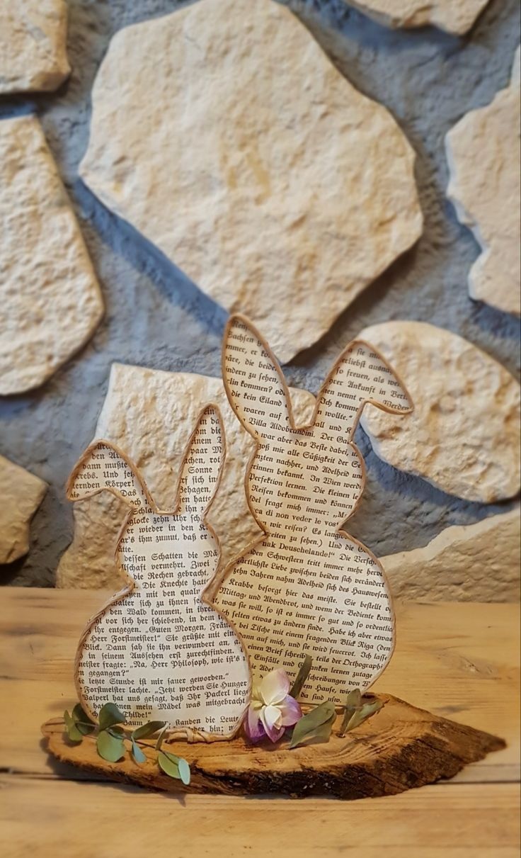 Photo of Easter bunnies in a double pack made of vine wire and old book pages.