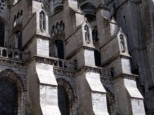 Chartres Cathedral - France 1193-1250  Flying buttresses, typical in the France's High Gothic period, allow for huge stained glass windows in between.