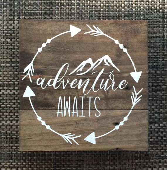 Adventure awaits wood sign, mountains, arrows, wooden sign