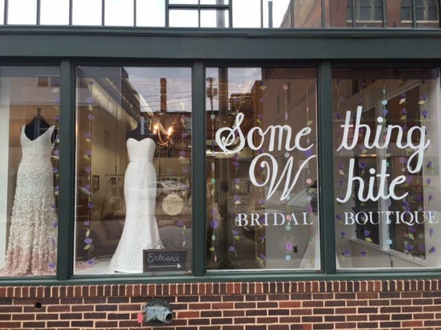 Spring window display at Something White Bridal Boutique.