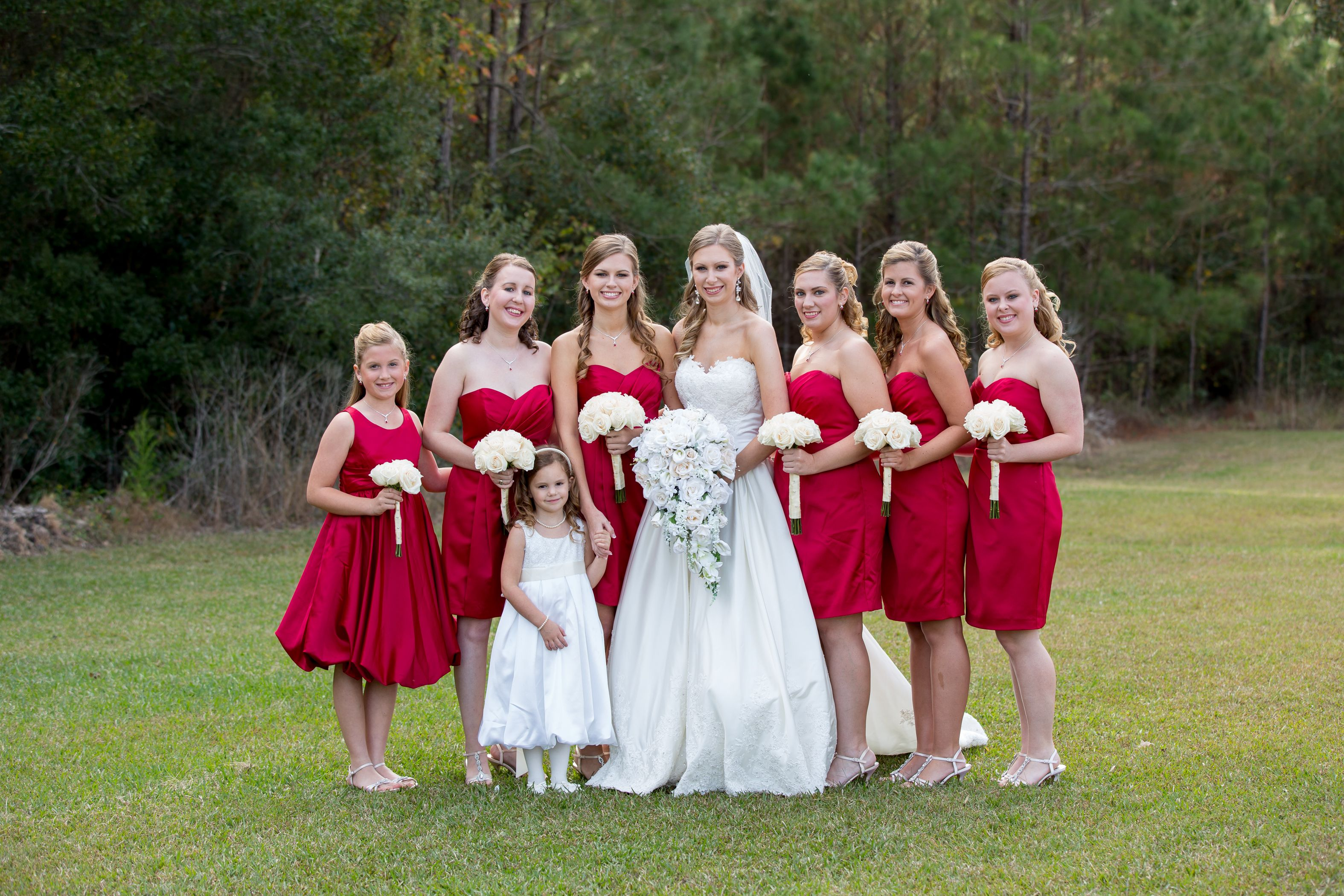 Bridesmaid and Bride- Red dresses and white roses.