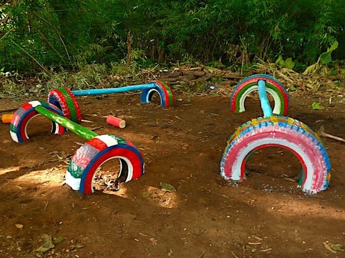 Playground ideas recycled tires balance beams kids for Childrens play yard