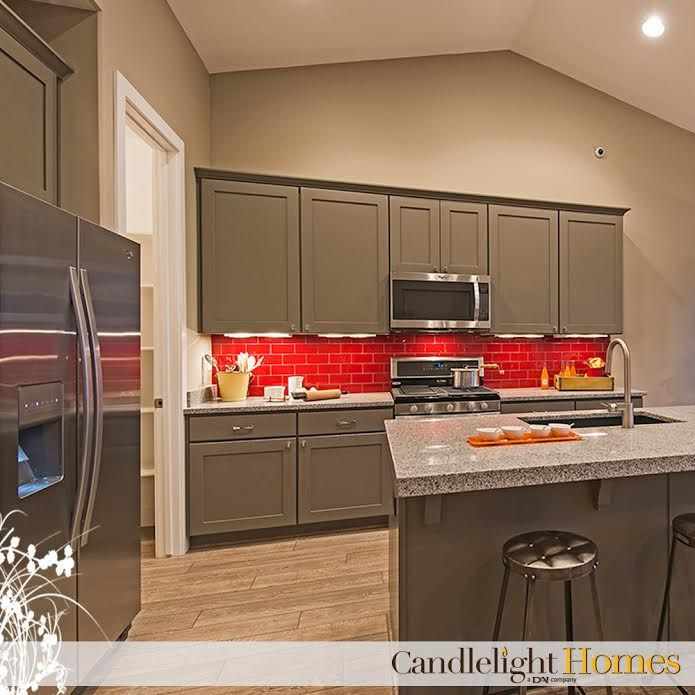 Colorful red backsplash and grey cabinets. Kitchen design ...