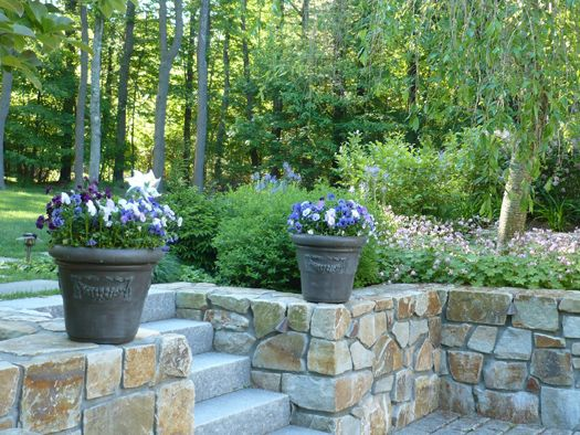 Stepping Stones Lead To Stone Retaining Wall With Granite