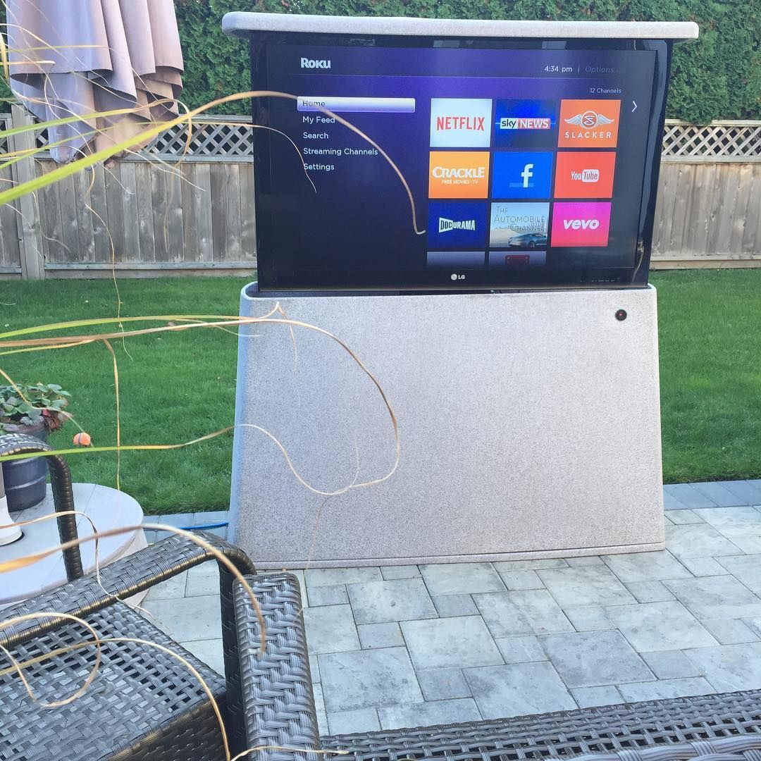 our outdoor tv lift cabinet and mechanism for watching the game in the back yard then when your done with it press the button and the tv drops back into