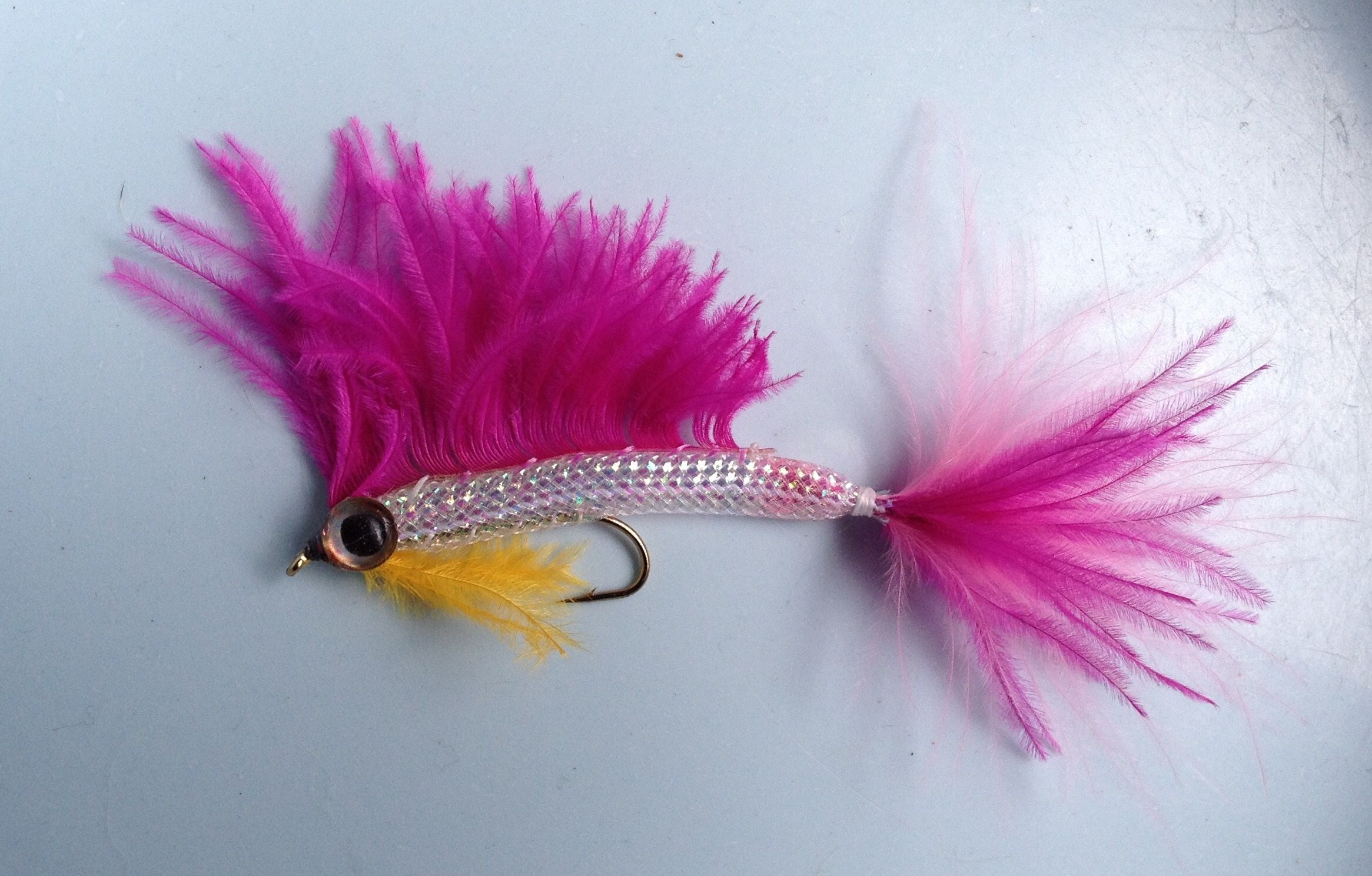 This is a Floozy Minnow. Size 4 hook, EZ body, and ostrich feathers.