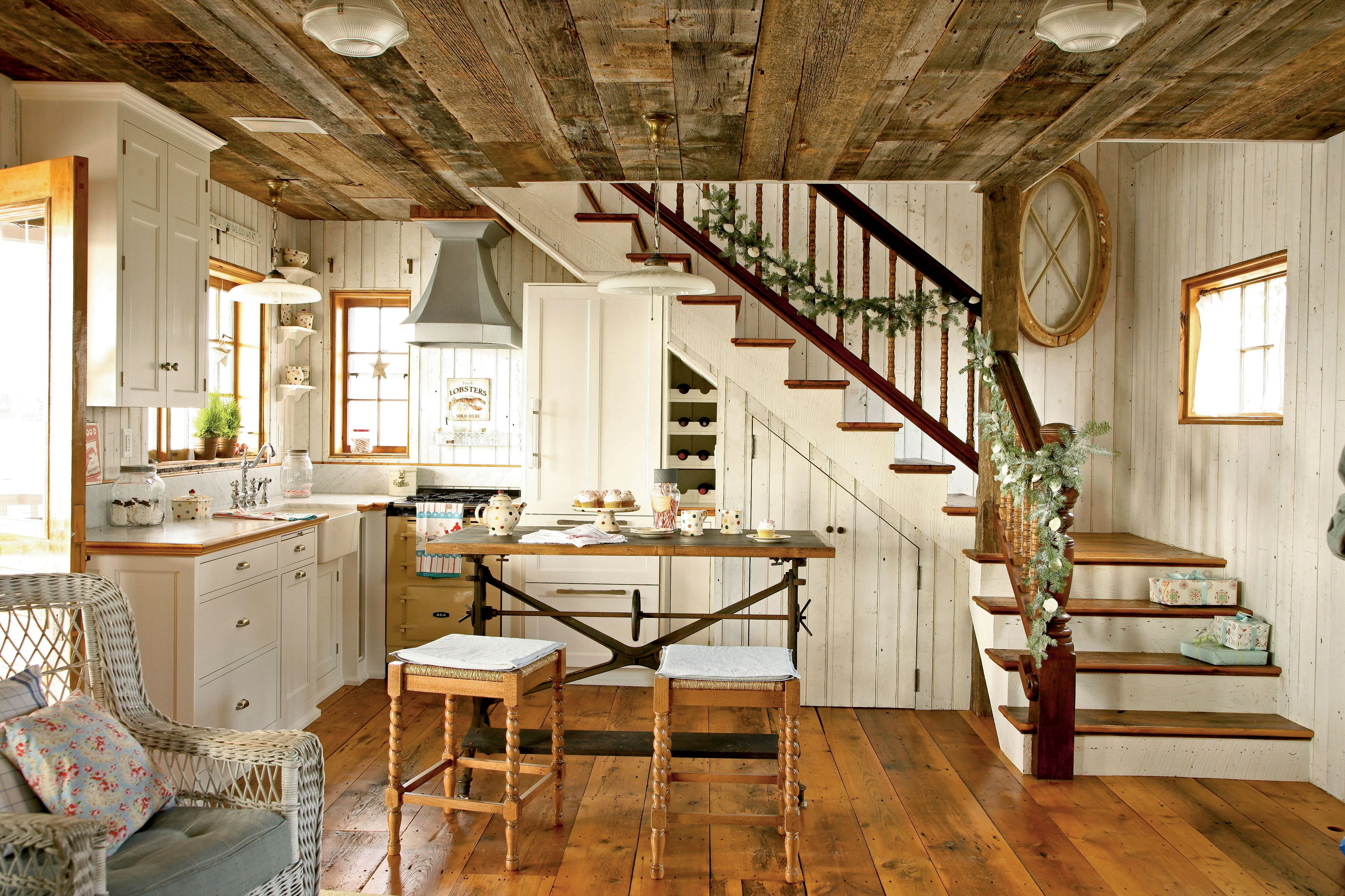 The Adorably Cozy Kitchen With Its Simple White Cabinetry And Walls And Tiny Stove And Hood Is Cottage Kitchens Cottage Style Interiors Cottage Interiors