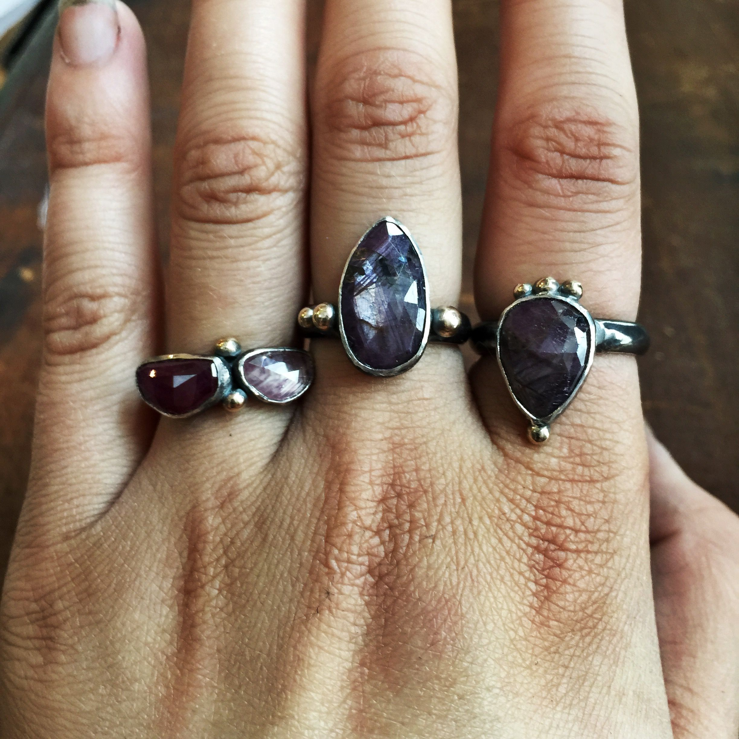 Gorgeous alternative engagement rings styles featuring sterling silver bands, sapphires & rubies, with 14kt gold accents.