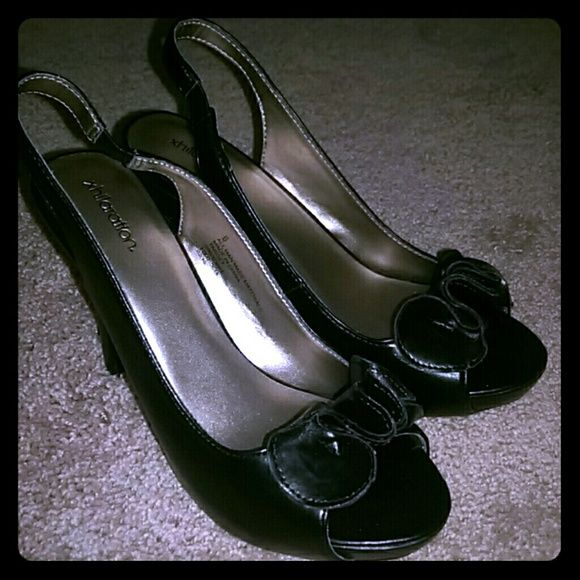 Xhilaration Black Pumps EUC black pumps size 6. Sling back with bow/floral decal at toe. 3 inch heel. Xhilaration Shoes Heels