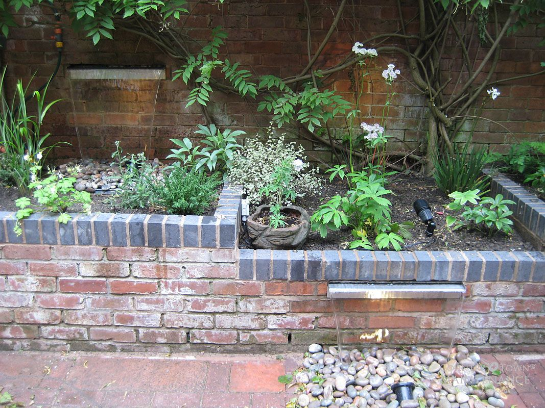 Brick wall Garden, Garden lighting, Lighting uk