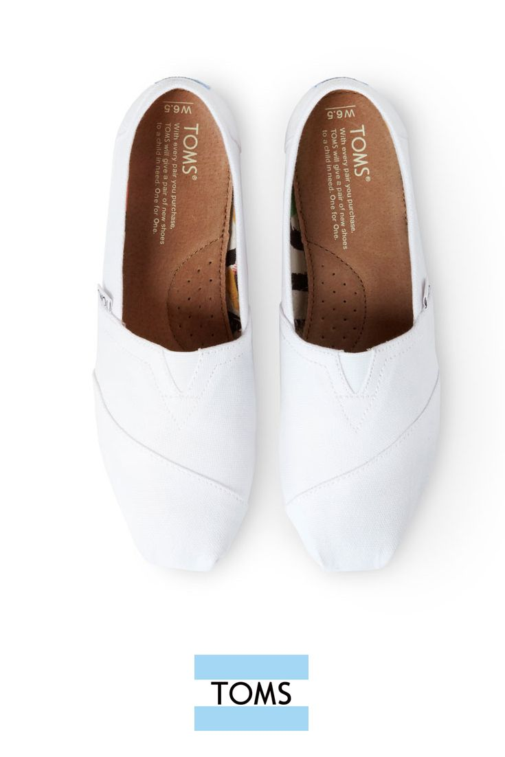 9f3d3943e88 Optic White Women s Canvas Classics from TOMS are officially back in stock.  Grab a pair of these crisp white slip-on shoes before they run out.