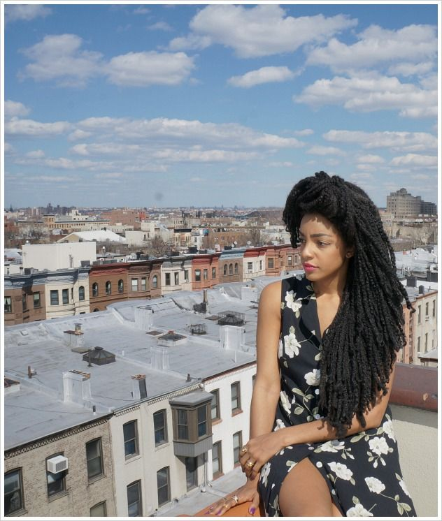 TK Wonder. This is her real hair and it is not locks. Check her and her twin sister on urbanbushbabes.com