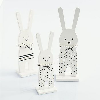 A simple wooden bunny that is the perfect Easter companion.  This bunny features black and white accents and can also be used as a table or shelf decoration to add a festive touch to your baby's nurse