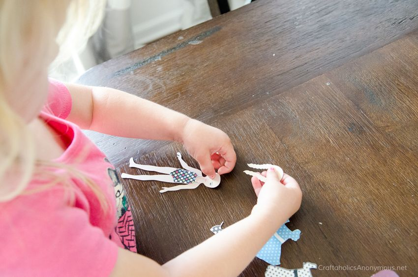 Magnetic Paper Dolls- When you're pregnant {and very sick}, you have to find ways to keep your littles preoccupied while you lay down and rest. Which is exactly what I did yesterday! I made the cutest little DIY Paper Dolls for little Miss D so I could enjoy some down tim
