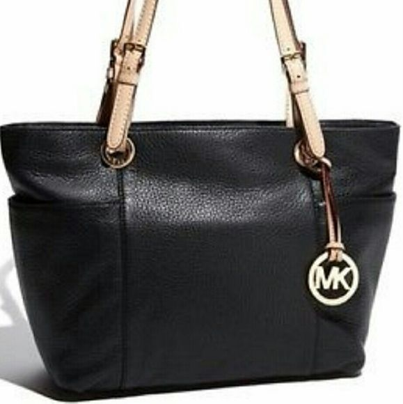 e418f9034452 Michael Kors Black Jet Set Top Zip Bag Michael Kors black leather purse  with tan straps