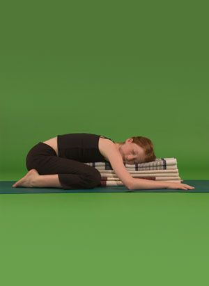 supported child's pose releases the muscles in the back