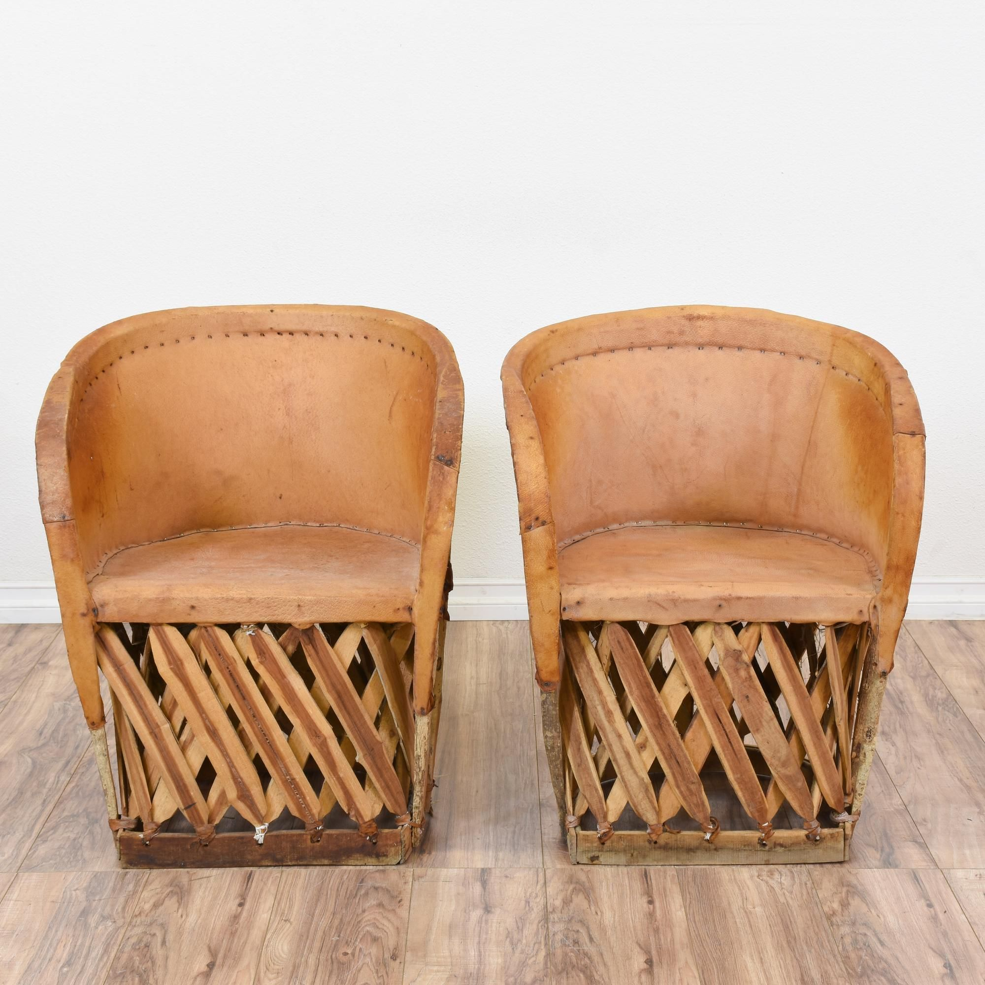 This pair of Mexican style equipale chairs are featured in a solid