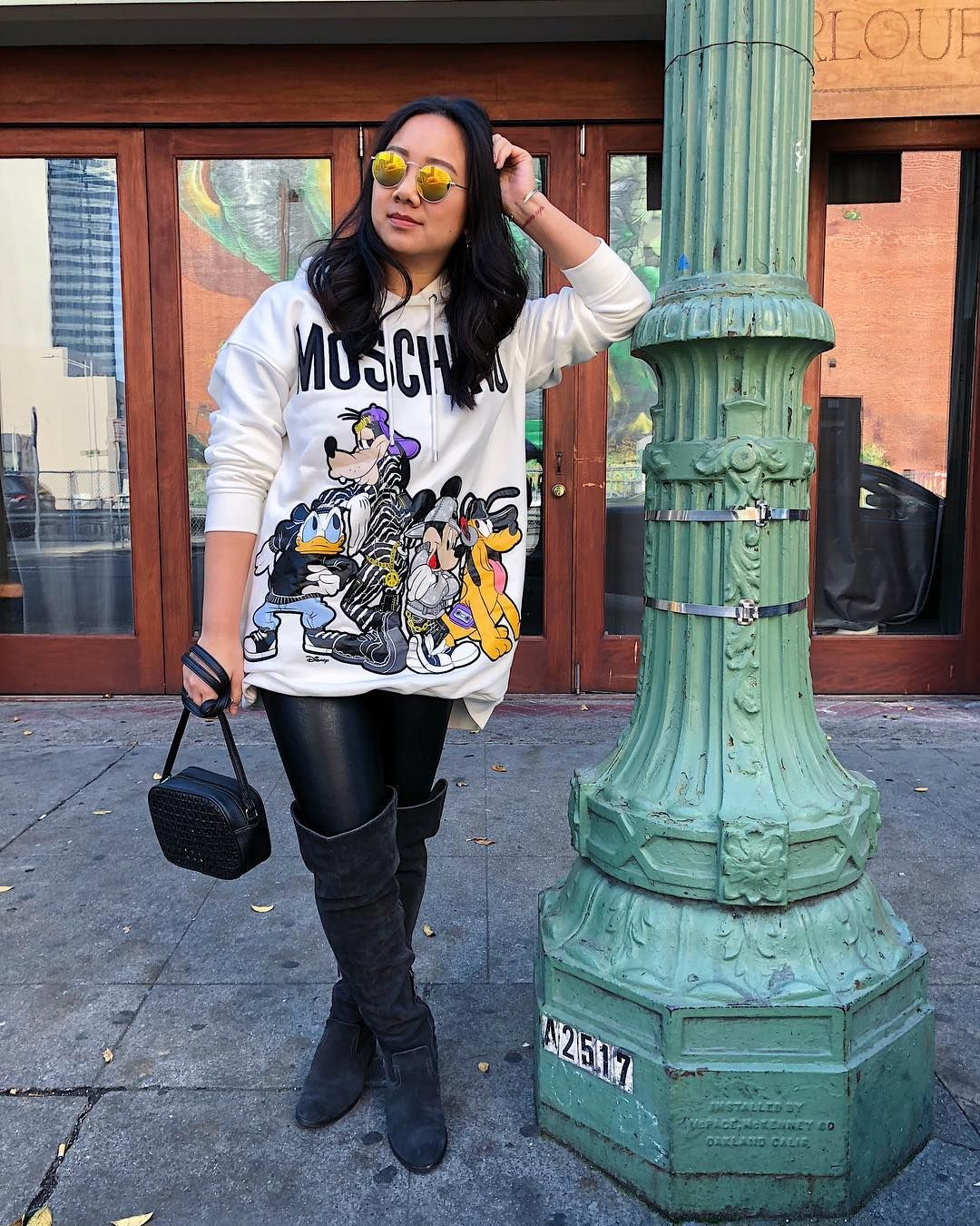 12c819276 H&M x Moschino Disney oversized sweater City street style with a Disney  twist is easy with the hmxMoschino collection! So many pieces featuring  Mickey and ...