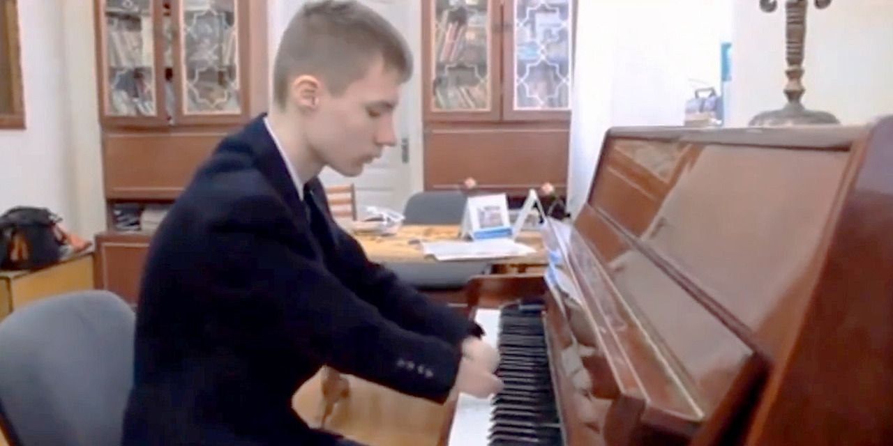 A pianist born without fingers has become a social media sensation in his home country of Russia after video footage of performing went viral.  Alexei Romanov was shown defying his disability and playing the piano in a performance which has earned him thousands of followers on social media and a spot