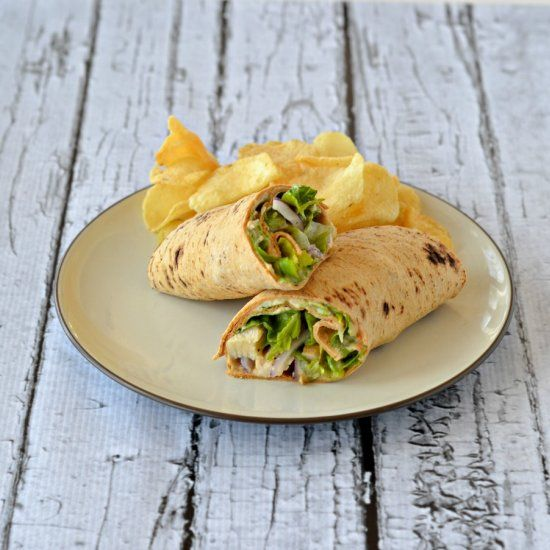 Chicken Caesar Hummus Wraps are stuffed with chicken, onions, Parmesan cheese, and hummus.