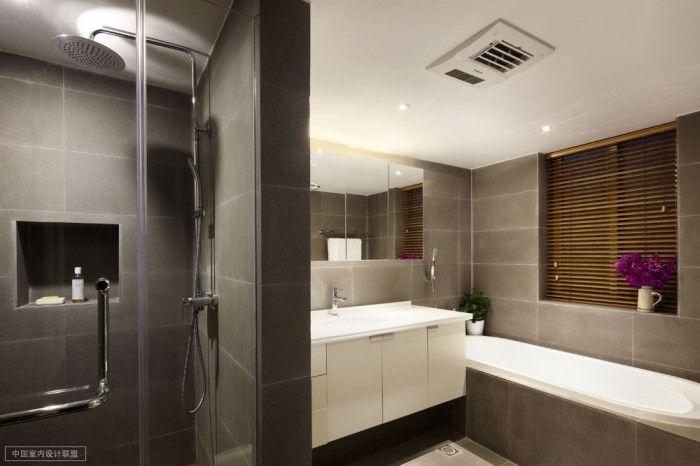 Shanghai apartment with modern minimalist flair elemental slate tiles sleek tub down lit bathroom