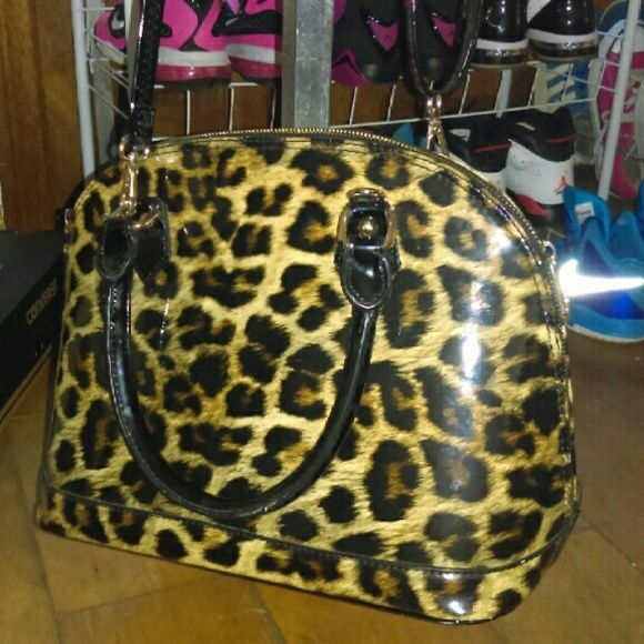 Leopard purse Super cute leopard purse , I've just had for a while ,no rips or stains , a lot of room on the inside ,shoulder strap,handles and zipper all work and are intact Bags