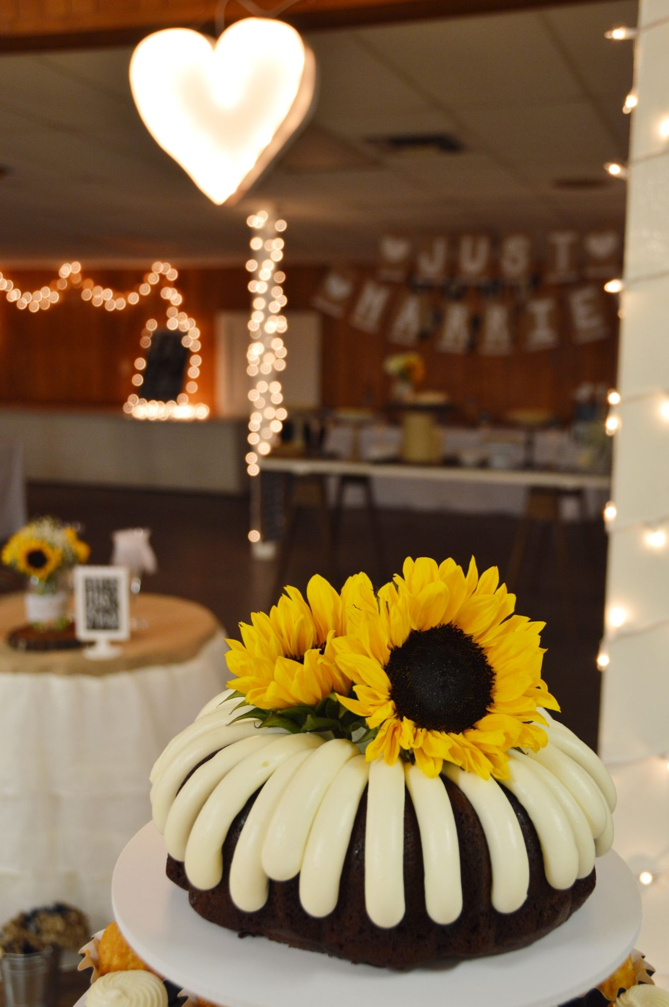 Sunflower Cake topper & Marquee heart light in background ...