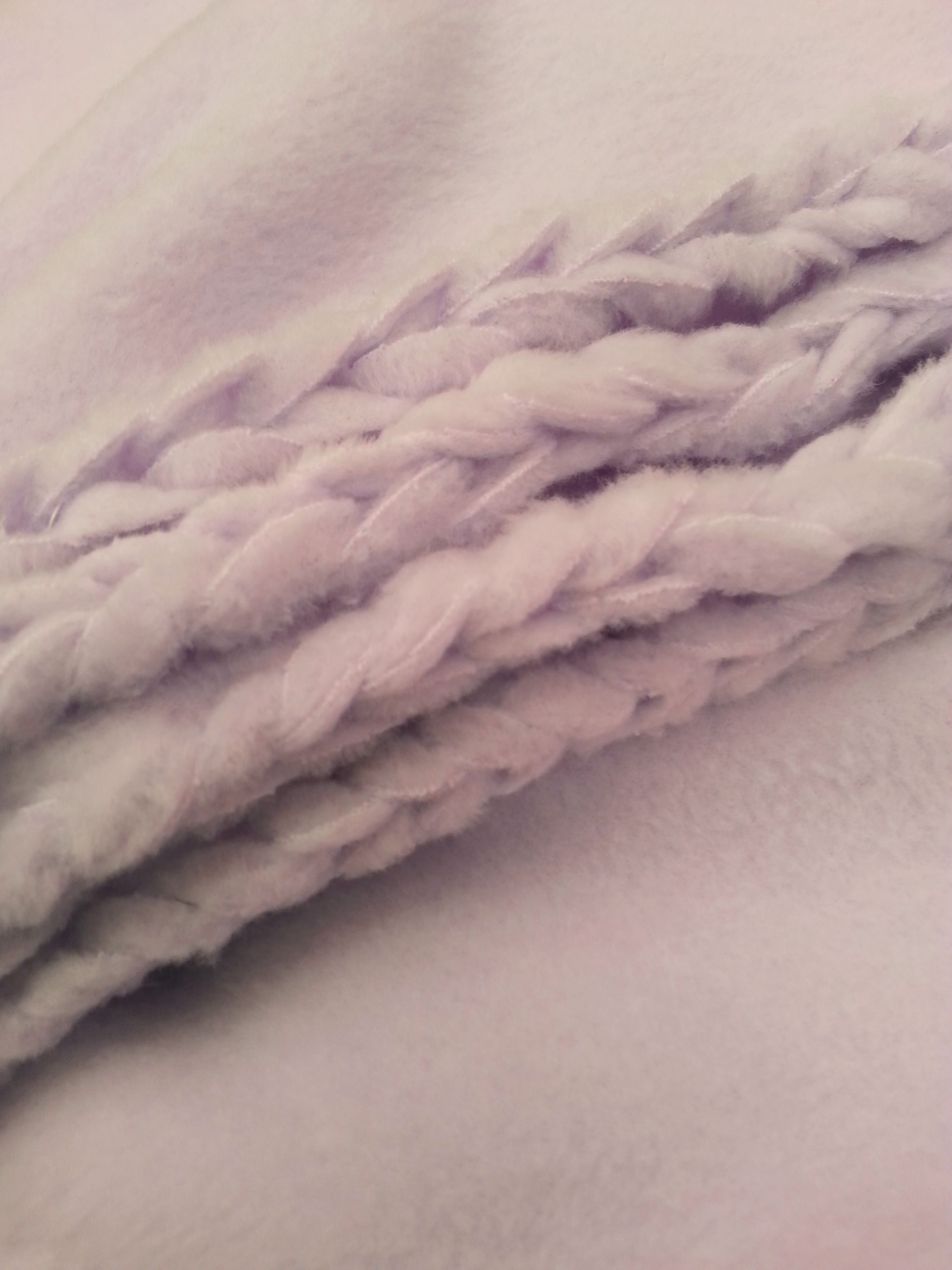 This is a fun way to finish the edge of a simple fleece blanket that