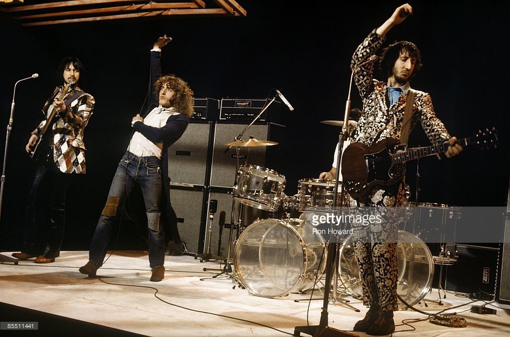 CENTRE Photo of The Who, L-R. John Entwistle, Roger Daltrey, Pete Townshend, performing on 'Into '71' TV show, with Hiwatt amplifiers behind