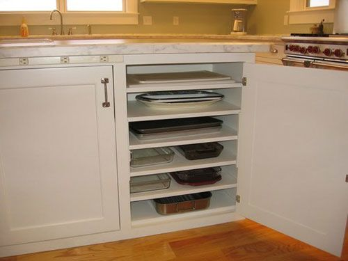kitchen storage ideas add additional shelves in lower cabinets to store flat items - Kitchen Cabinet Shelves