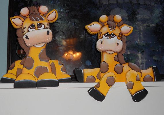 Adorable baby Giraffes woodcraft shelf sitter. $32.50 each, via Etsy.