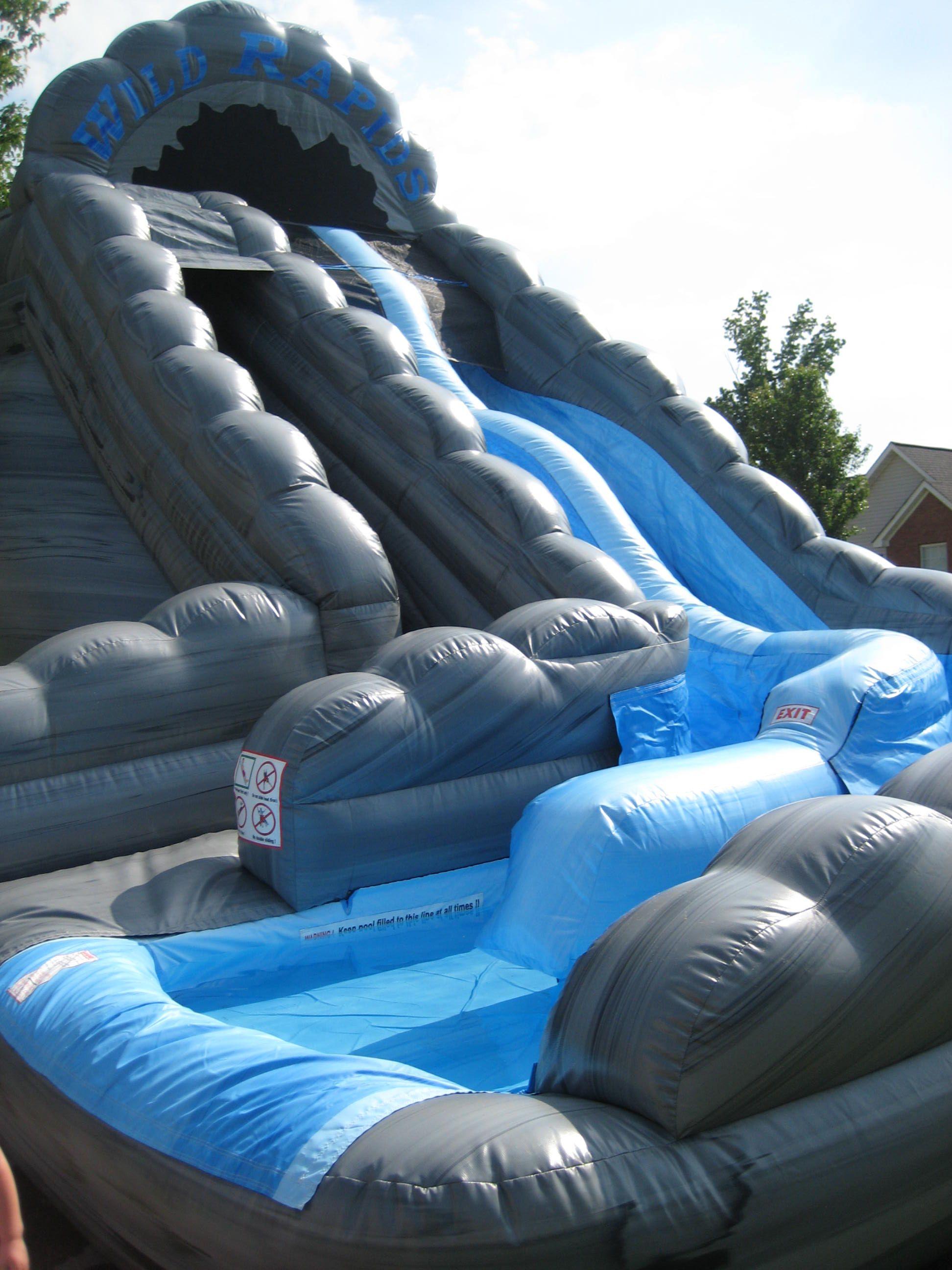 giant inflatable double lane slip slide commercial grade