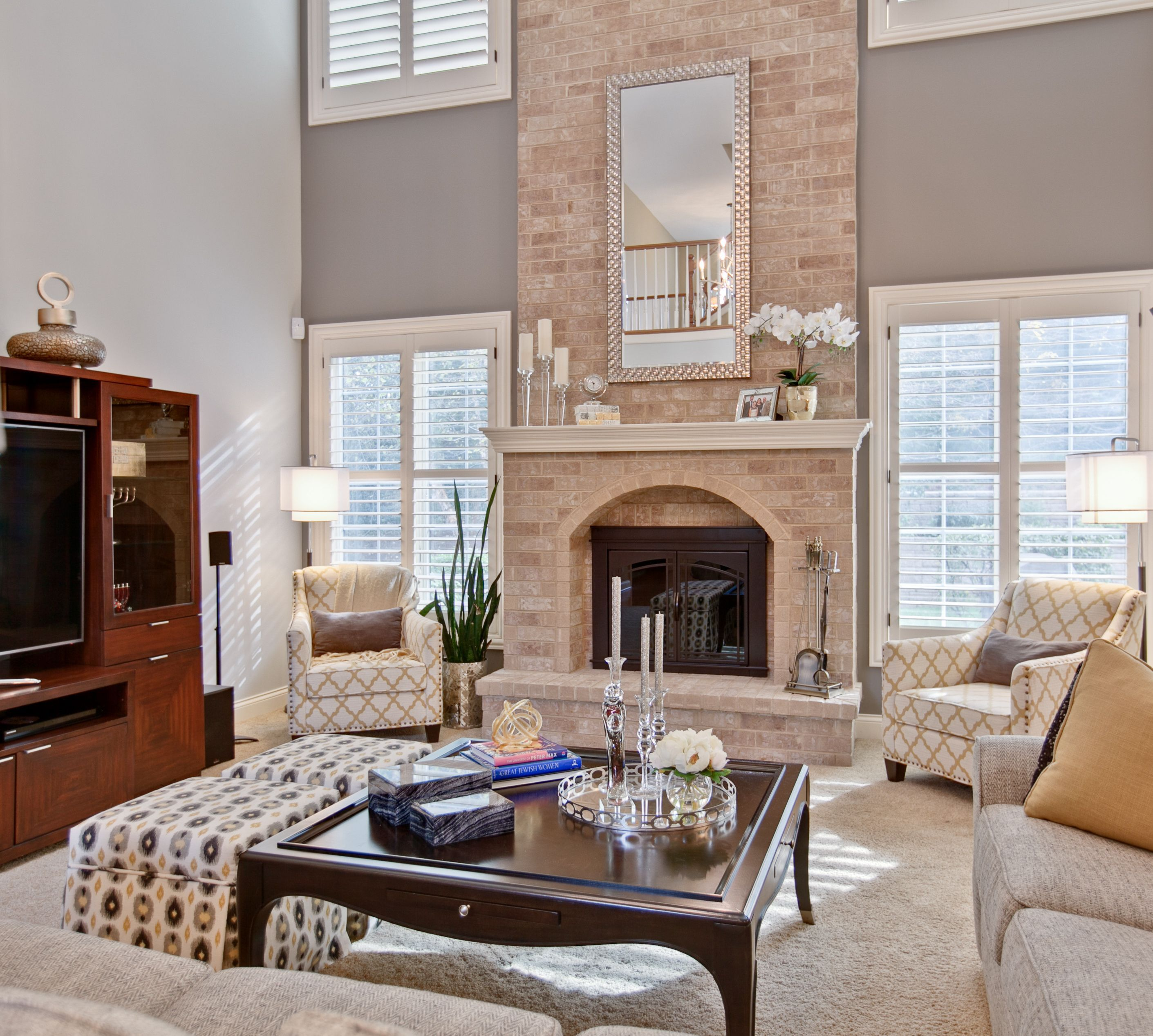great room with two story fireplace interiors with a view inc