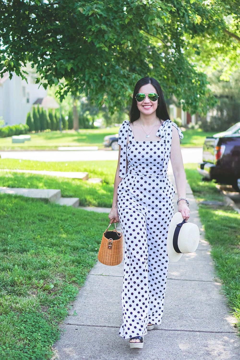d03c4ebe44bf This white and black polka dot jumpsuit with self tie shoulder straps
