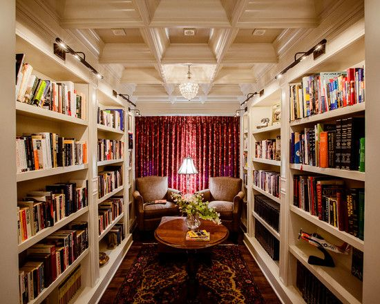 Home library with red curtain wooden ceiling panels brown chairs round coffee table rug Traditional home library design ideas
