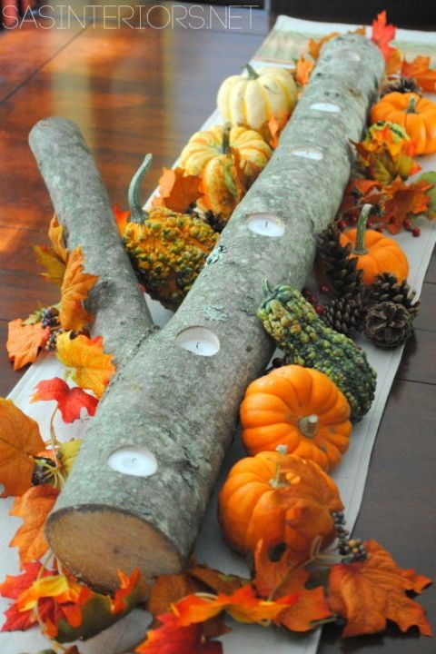 Log Centerpiece: Decorate a log from your backyard with gourds and fall leaves for a rustic masterpiece. Make it even dreamier by drilling holes into the log, and submerging votive candles down the middle.This DIY centerpiece is the perfect addition to any mantle, table, or even a party this Fall.For more beautiful, easy and inexpensive DIY Fall inspired centerpieces here.
