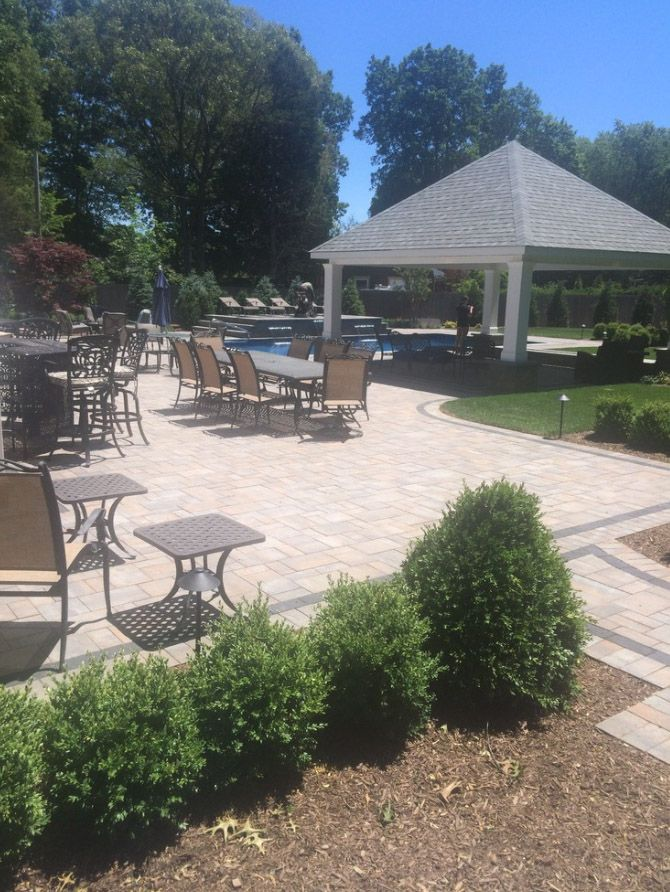 This beautiful Hauppaugue, New York Pool Patio was created ... on Houzz Outdoor Living Spaces id=92247