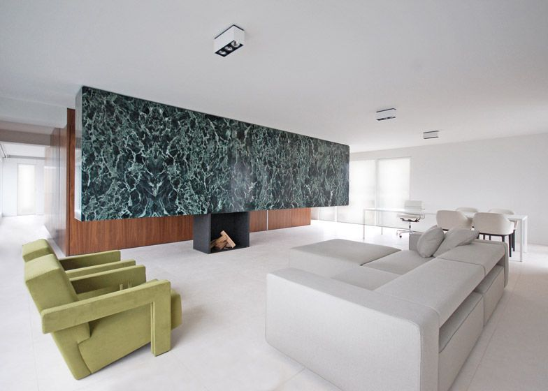 Marble In Antwerpen : Monolithic marble partition divides antwerp penthouse modernists