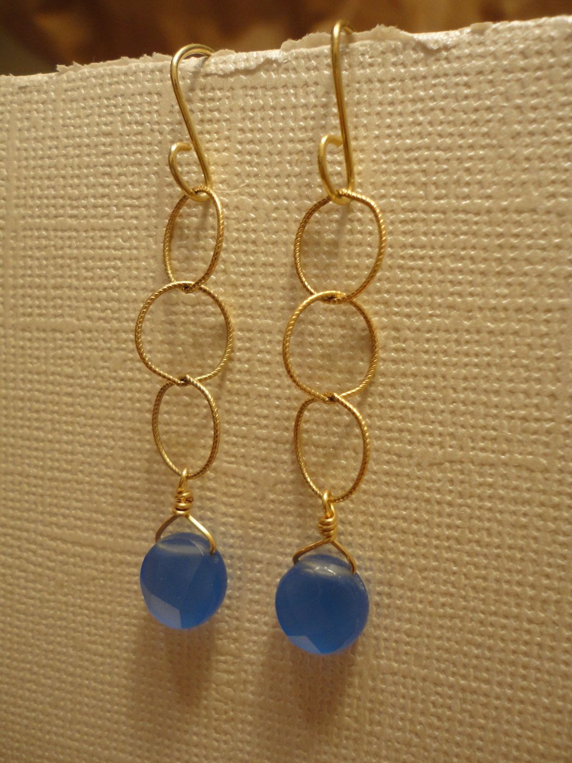 Gold chain with blue round topdrilled stone earrings. $13.00, via Etsy.