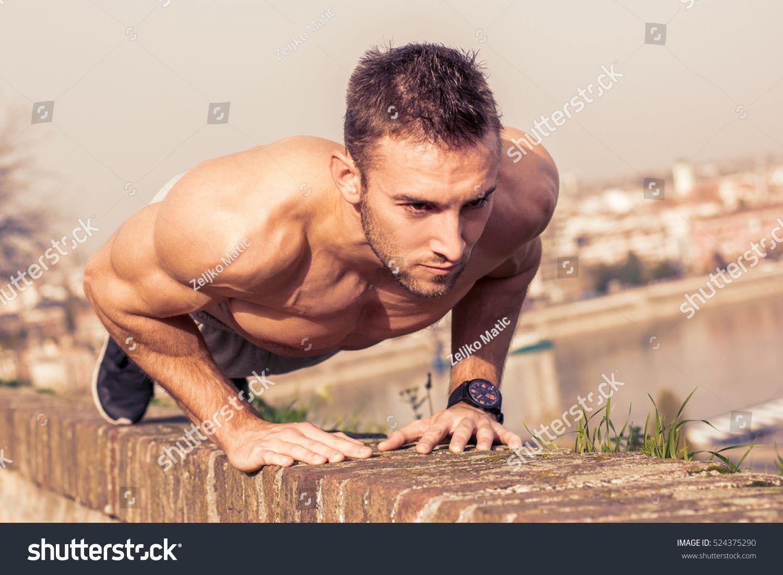 Man fitness model training pushups outdoors Ad , ad,