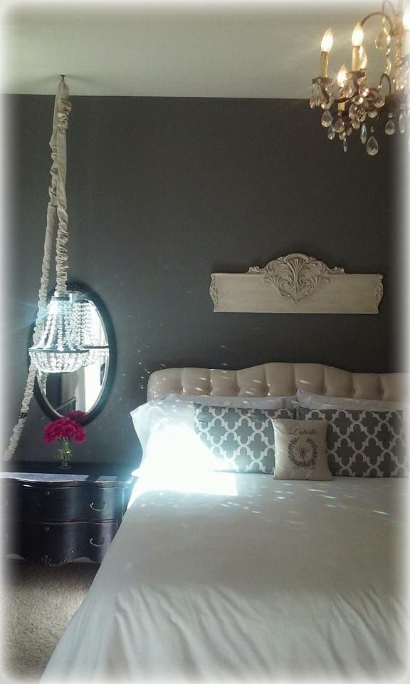 Grey Bedroom Black Serpentine Dresser Crystal Chandelier  Ballard Design Tufted Headboard Swag Lamp