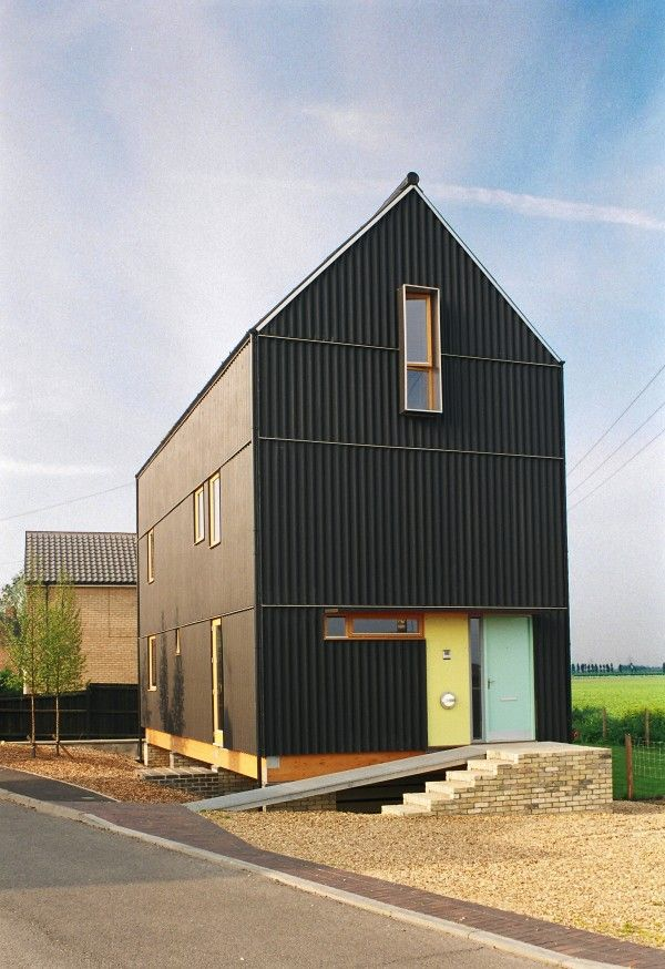 Fibre Cement Corrugated Cladding Painted Black Reference To Traditional Local Barns The Black House Ely Cambrid Architecture House Exterior Black House