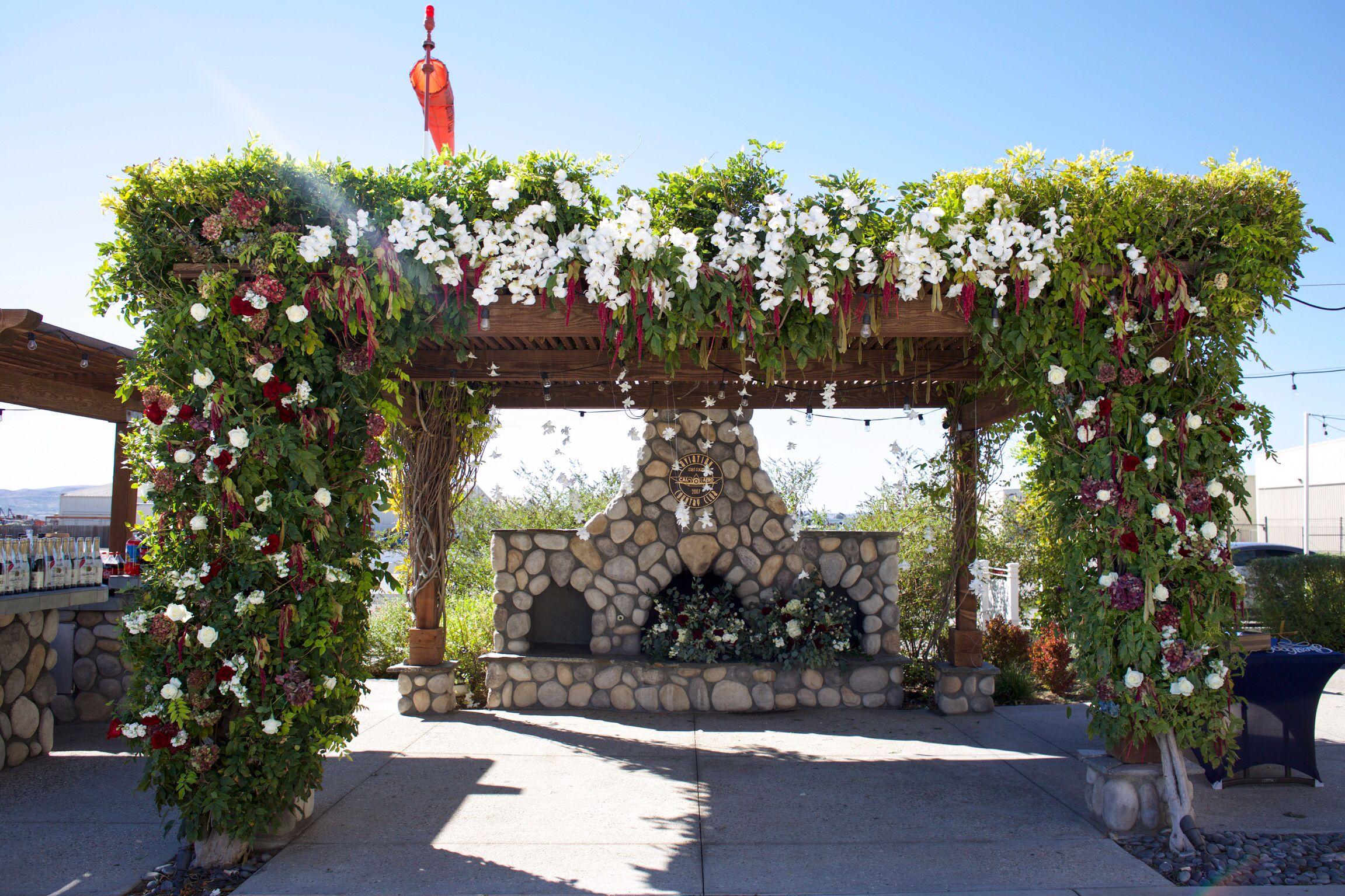 Gazebo arch ceremony flowers image by tommy austin