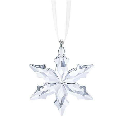 Add a touch of sparkling glamour to your holiday décor with Swarovski's elegant 2015 Little Star Christmas Ornament. This exquisite, petite star in shimmering crystal hangs from a white satin ribbon.