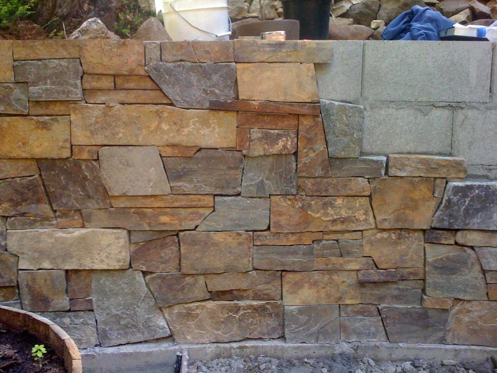 Stone veneer retaining walls google search deck and for Stone veneer vs brick cost
