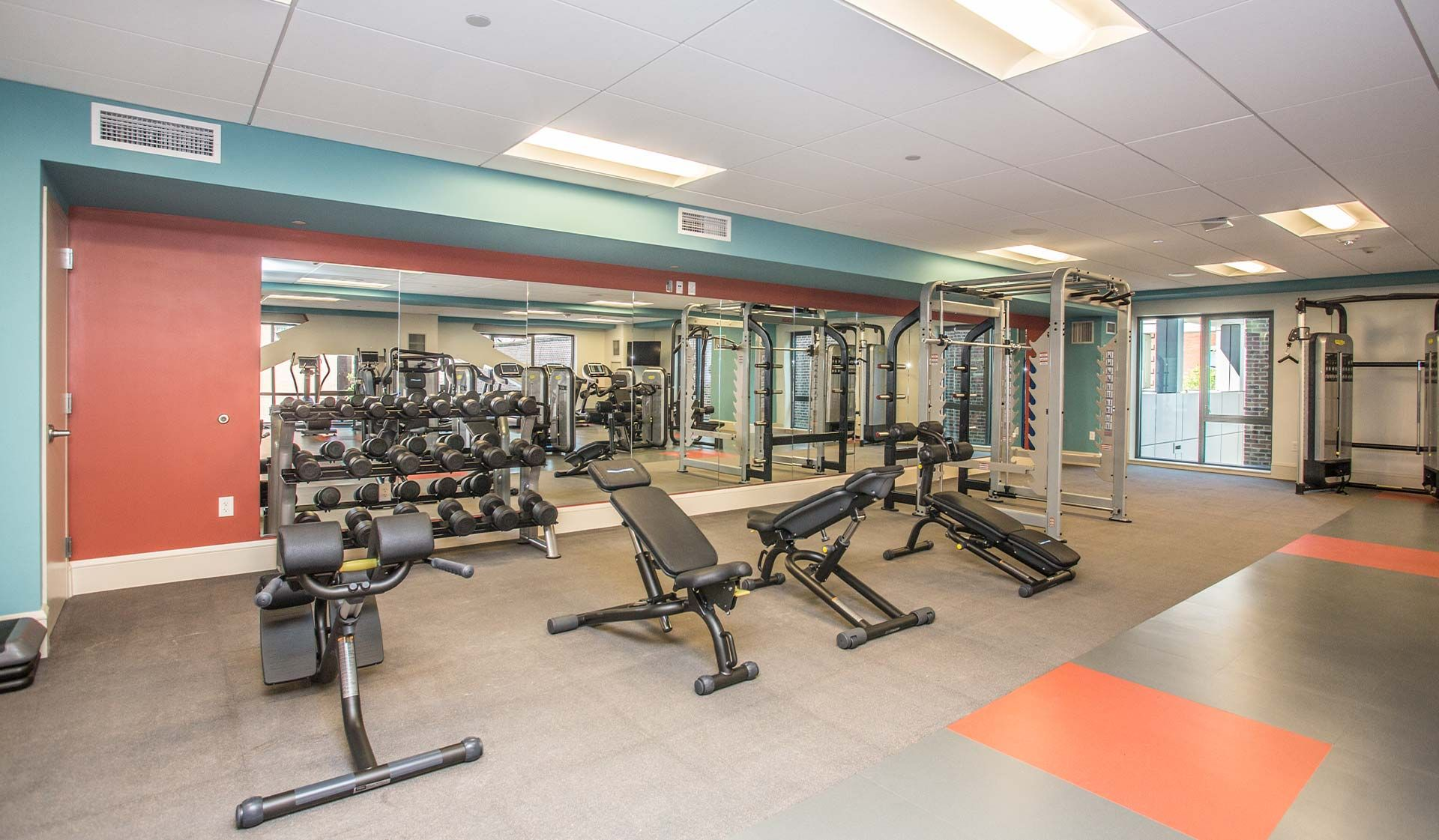 The Fitness Center Is Equipped With Both Free And Machine Weights Apartment Home Apartment Living